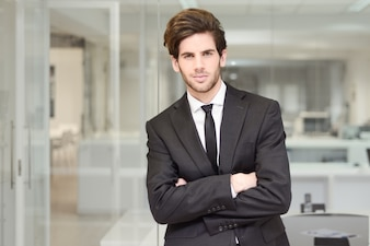 Young executive with tie and crossed arms
