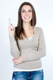 Young female putting her forefinger up.
