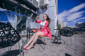Young girl taking a photo at a restaurant on the terrace