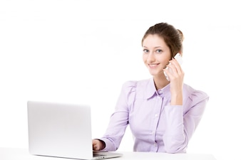 Young girl taking business call in front of laptop