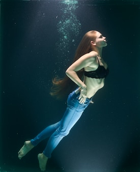 Young girl under the water