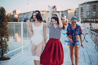 Young girls dressed in modern fashion walking