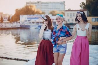 Young girls walking along a promenade
