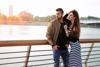 Young Handsome couple in love. Capturing bright moments. Joyful young loving couple on sunset. romantic.