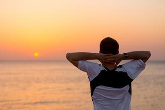Young man enjoying the sea view
