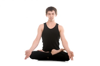 Young man in sportswear meditating