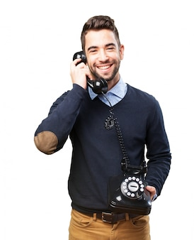 Young man laughing and talking on the phone