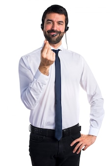 Young man with a headset doing money gesture