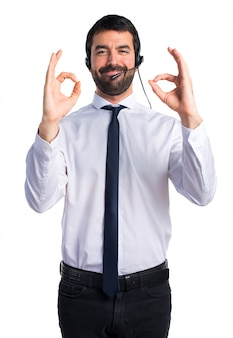 Young man with a headset making OK sign