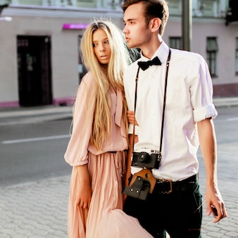 Young man with camera with his girlfriend