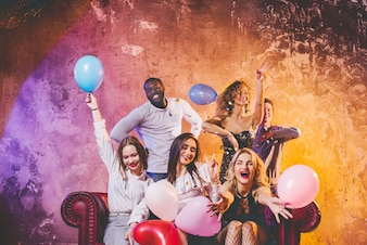 Young people having fun with balloons