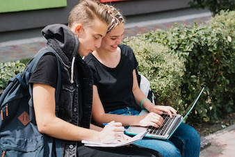Young people studying in park