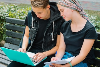 Young people studying with laptop