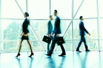 Young rush blurred businesswoman businessman
