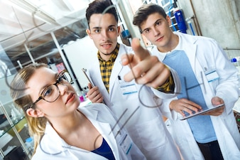 Young scientists carrying out an experiment in a laboratory.