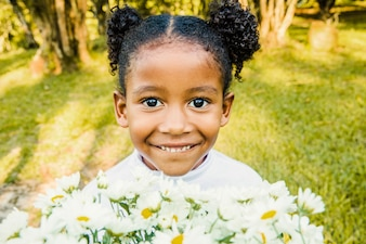 Young smiling girl with flower