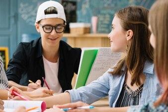 Young students chatting at desktop