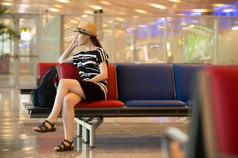 Young traveling woman waiting for trip