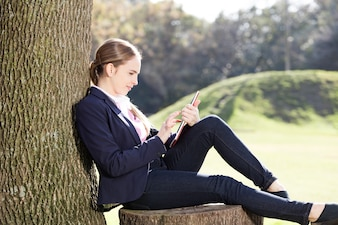 Young woman checking her email outdoors