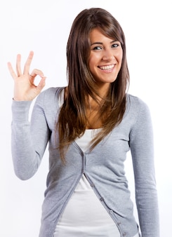 Young woman giving ok sign to camera