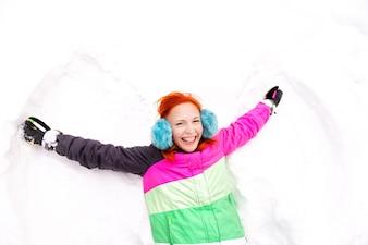 Young woman having fun in snow