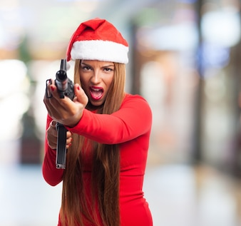 Young woman having fun with a pistol