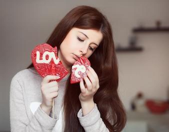 Young woman holding a broken lollipop