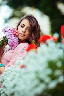 Young woman holding bunch of flowers