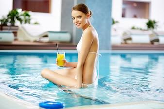 Young woman in bikini relaxing in the water