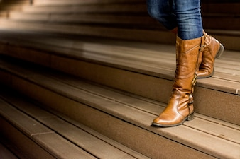 Young woman in leather boots