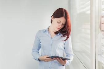 Young woman posing with tablet