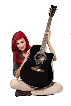 Young woman showing her guitar