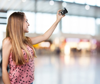 Young woman taking a selfie on white background