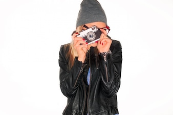 Young woman using her retro camera
