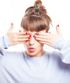 Young woman with painted nails covering her eyes