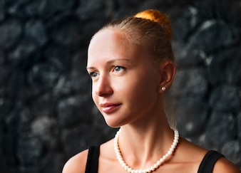 Young woman with pearl necklace and earrings