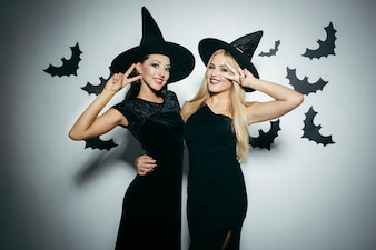 Young women dressed up for Halloween posing