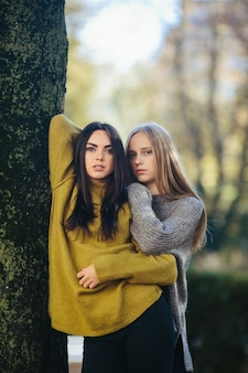 Young women standing in woods