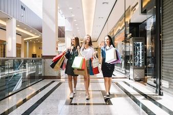 Young women walking in shopping center