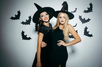Young women wearing witch hats on Halloween
