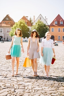 Young women with shopping bags on street