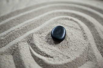 Zen garden with raked sand and stone