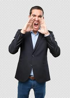 怒っているビジネスマンは叫ぶ
