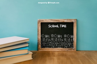 Back to school composition with slate and books