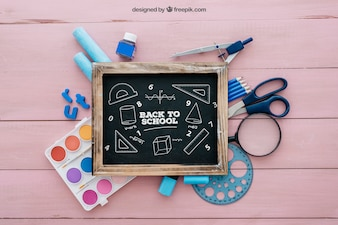 Back to school composition with slate on wooden surface