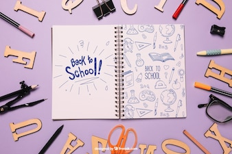 Back to school mockup with notebook and letters