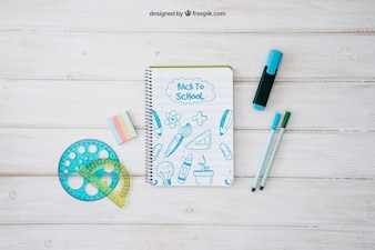 Back to school mockup with notepad and set square