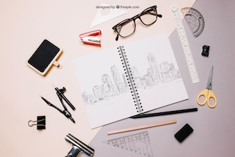 Back to school mockup with spiral notebook and glasses