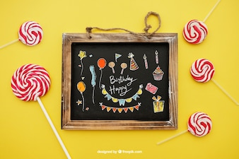 Birthday concept with lollipops and slate