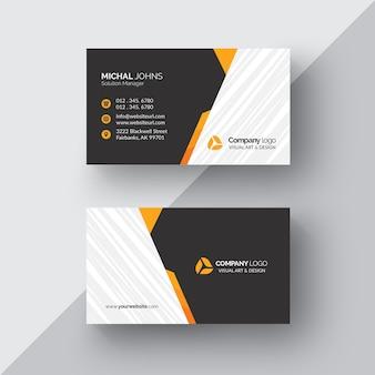 Black business card with orange details